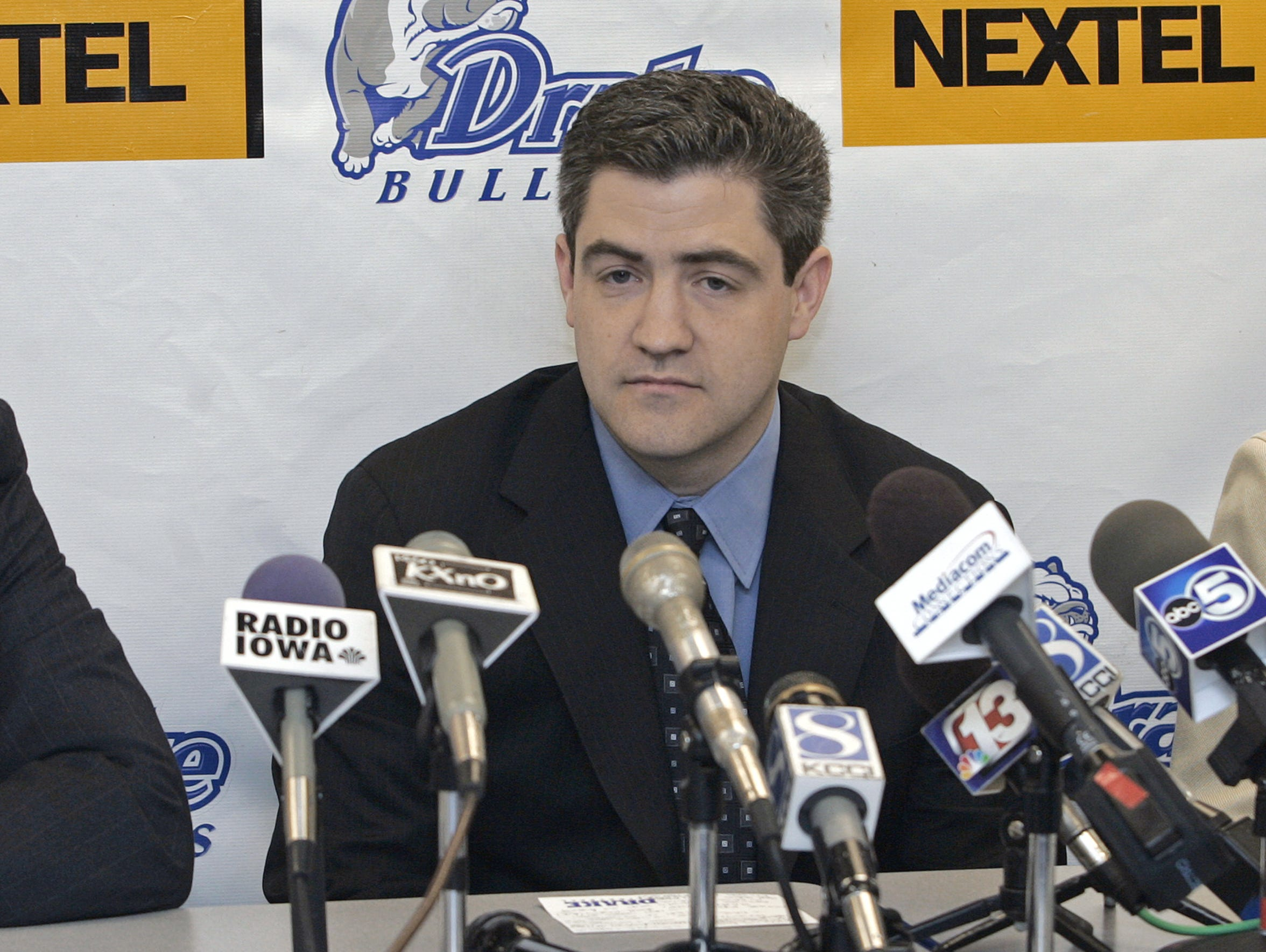 Keno Davis listens as he's announced in March 21, 2007