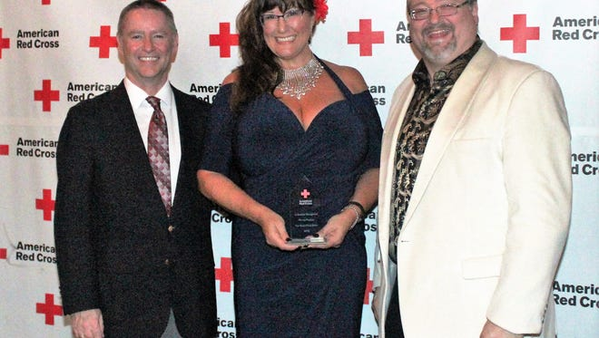 Kim Woolsey and Primex Plastics received an award from the American Red Cross for their volunteer efforts.