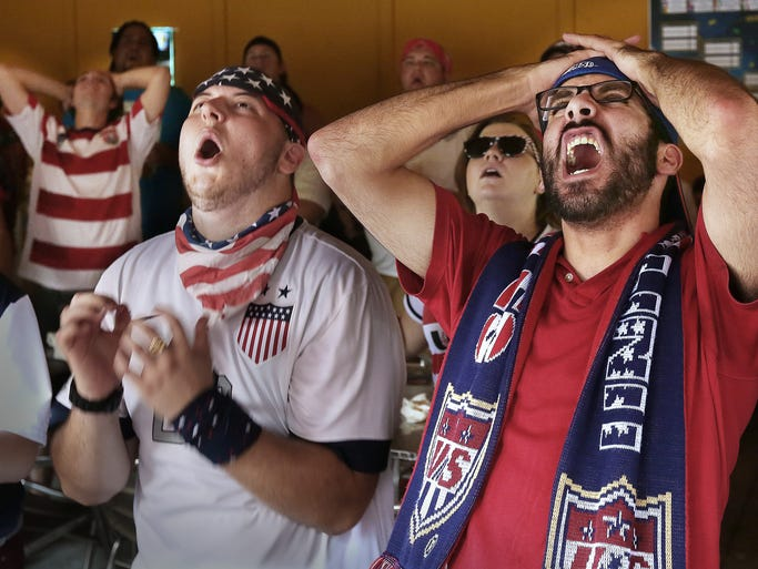 Andrew Barclay (right) and Cody Gillard react after an American kick went just wide against the Germans. Rabid soccer fans watched U.S.A play mighty Germany in a  match at the Parlay Sports Bar and Grill on Thursday, June 26, 2014.  The American Outlaws (Tallahassee's main soccer fan group) were in attendance at Parlay. The USA team gave up just one goal to the Germans, but it was enough for the 1-0 German victory. Despite the loss by the Americans, Team USA will play another day as Portugal beat Ghana 2-1.