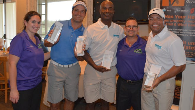 (Left)Alicia Carr and (second from right) John Carr congratulate the winners of the 2016 JRC Consulting Group Charity Golf Tournament, Eric Depp, Jason Elsner and Chris Cole.