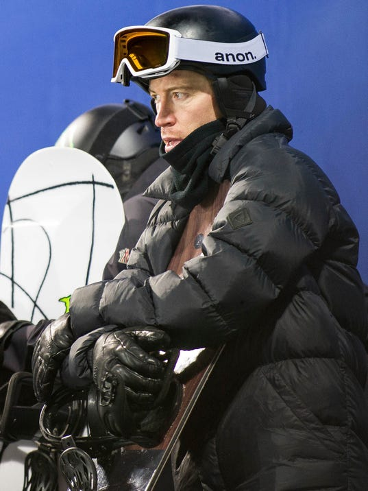 FILE - In this Jan. 24, 2018, file photo, U.S. halfpipe snowboarder Shaun White waits to take a practice run at the Winter X Games in Aspen, Colo. White says he is working on the tricks that Japan's Ayumu Hirano used to win the Winter X Games last month. Hirano became the first person to string together back-to-back 1440-degree jumps in what was widely regarded as the best show snowboarding has ever put on in a halfpipe. White says he's working on the back-to-back 1440s, too, and insists the world hasn't seen his best run yet.  (Anna Stonehouse /The Aspen Times via AP, File)