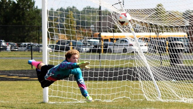 River Valley boys soccer goalkeeper Carter Layton dives to make a save during a match.