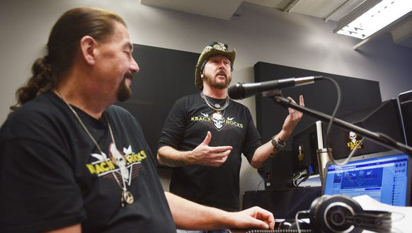 "Crash, left, and ""Metal Cowboy"" Ron Keel, right, host"