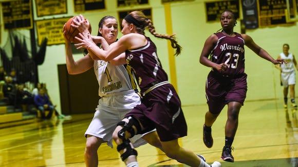 Delone's Maddie Comly moves around  Gettysburg defender Hailey Bortner to score on Dec. 13 during a girls' basketball game at Delone Catholic High School.  (Shane Dunlap - GameTimePA.com)