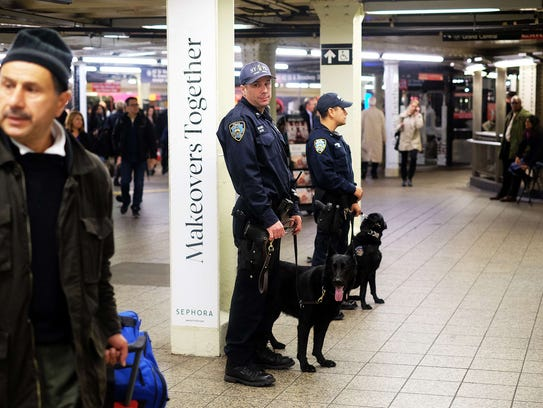 New York Police Department officers with a canine unit