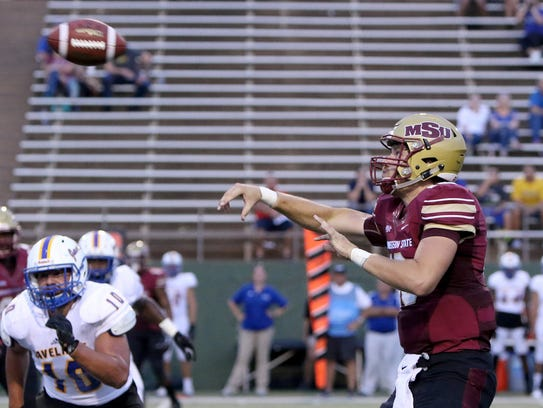 Midwestern State's Layton Rabb passes in the game against