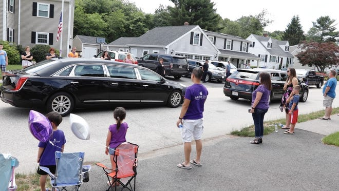 Neighbors pay their respects to Laurie Melchionda during a procession on Howie Road in Braintree following her funeral on Thursday, June 25. Greg Derr/The Patriot Ledger