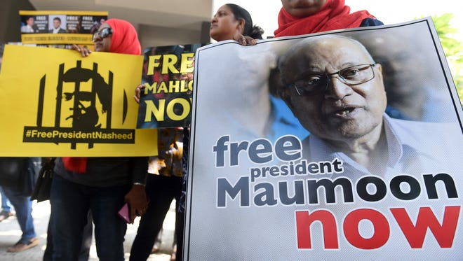 Supporters of former Maldivian president Mohamed Nasheed take part in a protest against the current Maldives President Abdulla Yameen, demanding the release of opposition political prisoners in front of the Maldives embassy in Colombo on March 6, 2018.