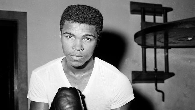 Cassius Clay, shown in 1962, changed his name to Muhammad Ali in 1964.