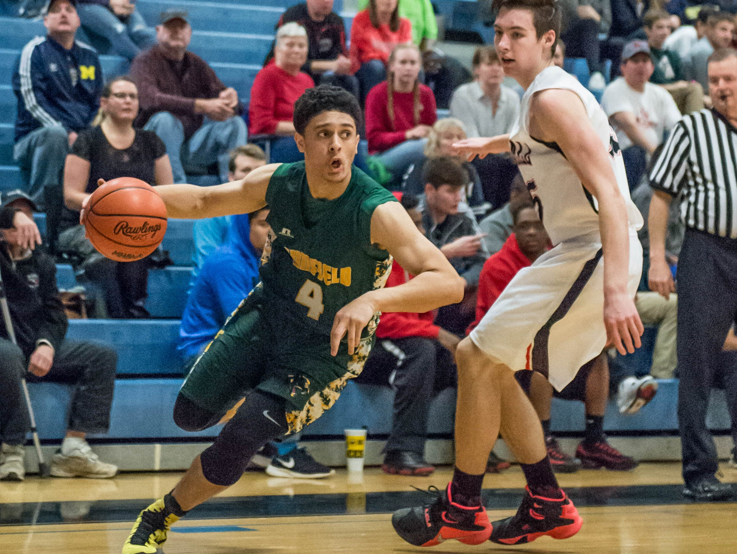 Pennfield's Deveaire Todd (4) drives to the basket during Monday's district game.