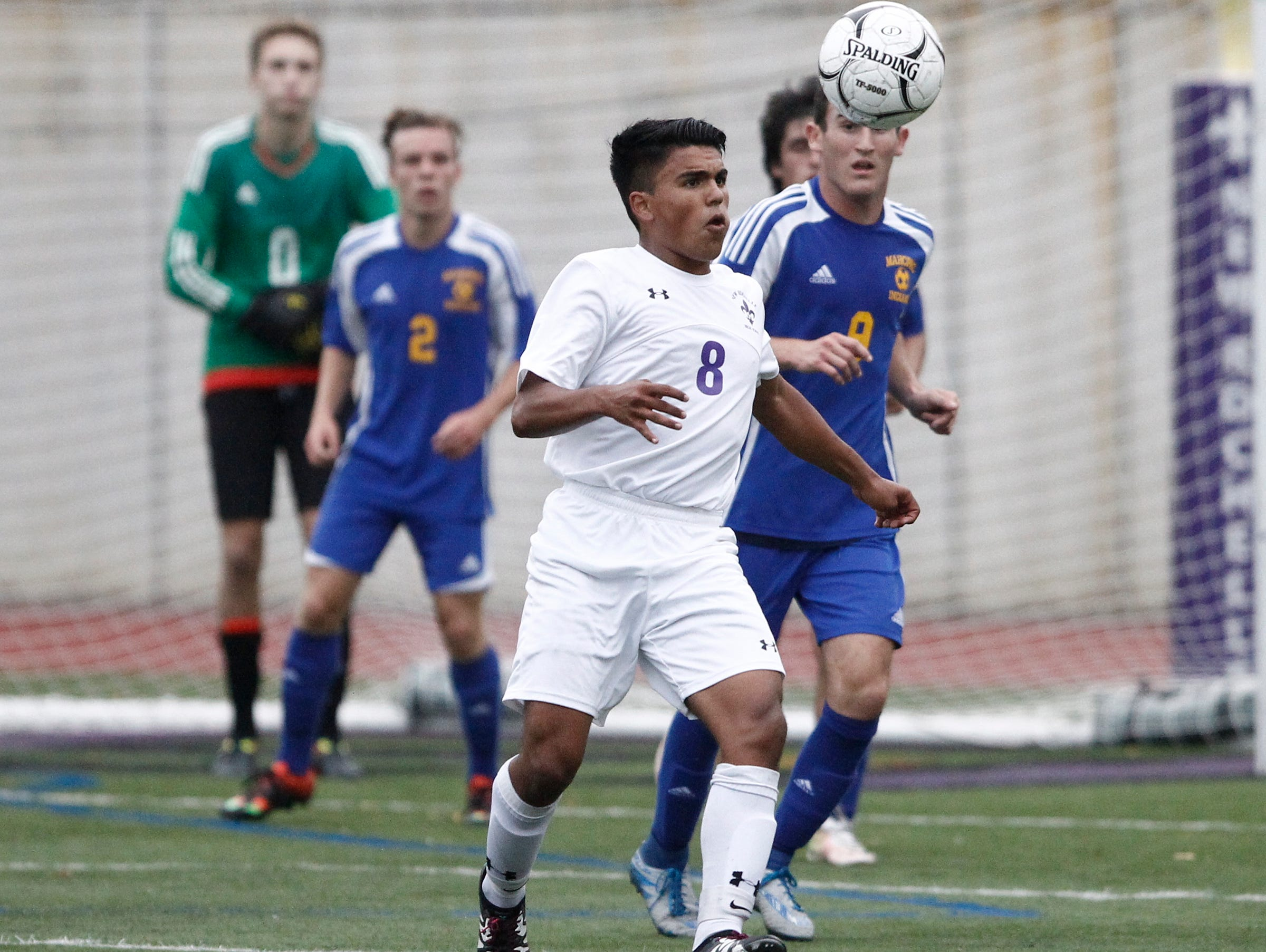 New Rochelle's Omar Espinoza (8) works to control the ball as Mahopac's Max Lichtman (9) defends during the boys soccer Class AA first round at New Rochelle High School in New Rochelle on Thursday, October 20, 2016. New Rochelle advances with their 2-0 win.