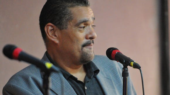 FILE PHOTO: John Torres, Florida Today News Columnist Discusses his latest project Murder on the Space Coast infront of a packed house Wednesday evening at Florida Discount Music Open Mikes in Melbourne. The story is about Gary Bennett who has served 34 years for the murder of Helen Nardi.