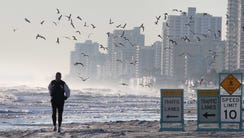A lone jogger takes his morning run on Daytona Beach, which came in as the best place to retire on a budget.