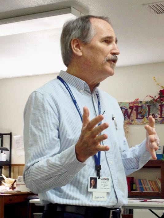 Dr. Neal Bowen, chief mental health officer for Hidalgo Medical Services, discusses the switch over of services from La Frontera to HMS on Wednesday at New Beginnings in Silver City. HMS takes over as the county's Medicaid-funded mental health provider on June 1. Randal Seyler Sun-News