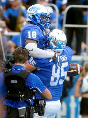 MTSU's Tavares Thomas (18) celebrates a touchdown over FIU with Darrius Liggins (85) during the game Oct. 7, 2017.