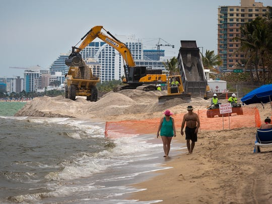 Dump trucks deliver sand from the Ortona Mine in Glades County to Broward County beaches as part of a $55 million beach renourishment in March 2016.