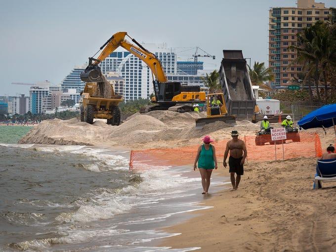 Dump trucks deliver sand from the Ortona Mine in Glades