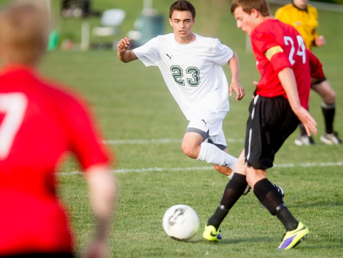 West High's Antonio Sanchez pursues the ball during the Trojans game against Linn-Mar in Iowa City, IA on Tuesday, May 6, 2014.