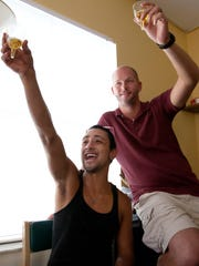 Anthony Esparza, left, and William Ullrich celebrate Thursday's Monroe County ruling.