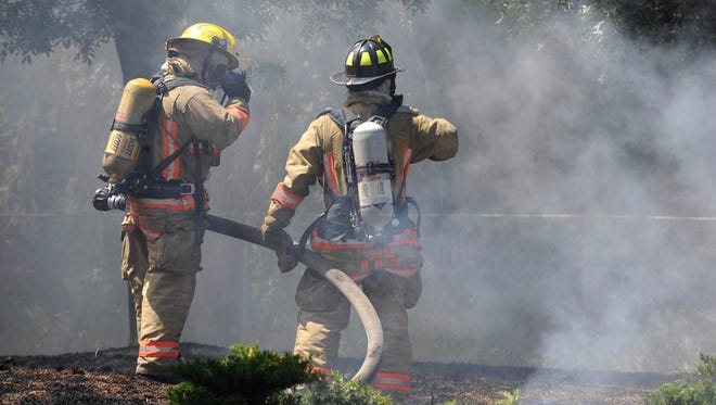 Firefighters work a house fire in southwest Reno in 2011.
