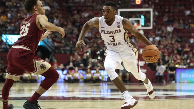 FSU's Trent Forrest drives past Boston College's Jordan Chatman during their game at the Tucker Civic Center on Saturday, March 3, 2018.