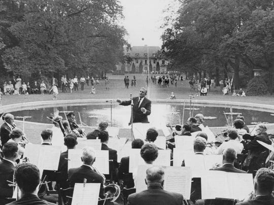 Renato Pacini directs the Indianapolis Symphony Orchestra Ensemble during at the first Penrod Arts Fair in 1967 at Oldfields.