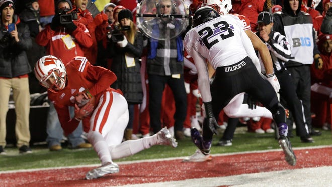Wisconsin wide receiver Jazz Peavy appears to make the game-tying catch against Northwestern last November at Camp Randall, but the catch was reversed on replay.
