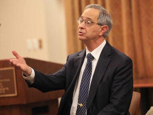 President Joel Seligman addresses questions presented to him during one of three townhall meetings scheduled to discuss the final report by the Commission on Race and Diversity at the University of Rochester on Tuesday, Nov. 1, 2016.