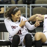 Tournament MVP Deja Turner has some fun after her team's 53-43 win over Holmes in the championship game of the Girls' Ninth Region Basketball Tournament at NKU March 8. Abby Hassert, right, was named to the all tournament team.