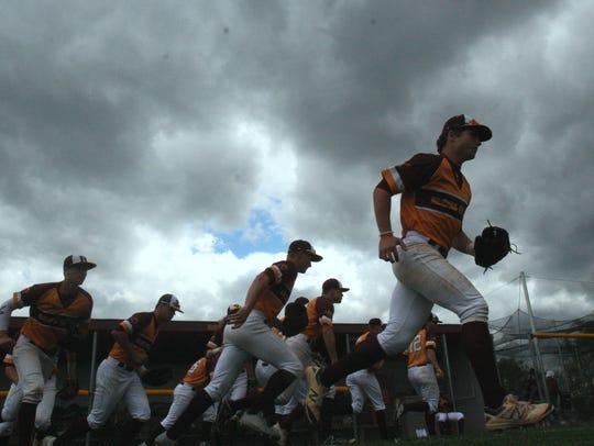 Ross High School's baseball team takes the field against