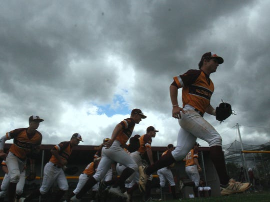 Ross High School's baseball team takes the field against