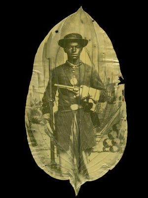 """""""War Memoranda: Photography, Walt Whitman, and Renewal by Binh Danh and Robert Schultz,"""" opening Sunday, Aug. 21, at the MAG, includes this image titled """"Unidentified African American soldier with cannon backdrop."""""""