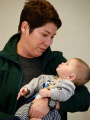 Sparrow Dr. Mary Pugmire an OB-GYN, holds 17-week-old