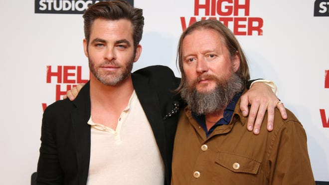 Actor Chris Pine and director David Mackenzie pose for photographers upon arrival at the photo call for the film 'Hell Or High Water' in London on Sept. 8.