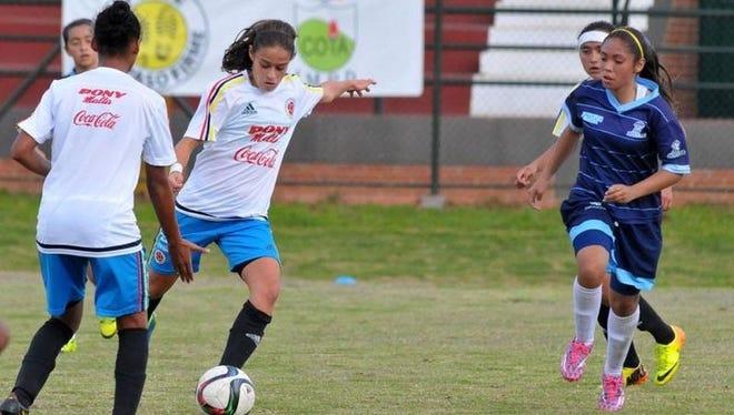 Marcela Montoya, an Ida Baker High senior, dribbles for trying out for the Under-20 Colombian women's soccer team.