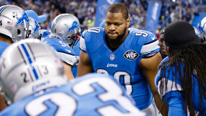 Detroit Lions defensive tackle Ndamukong Suh gets introduced before a game against the Chicago Bears at Ford Field in Detroit on Nov. 27, 2014.