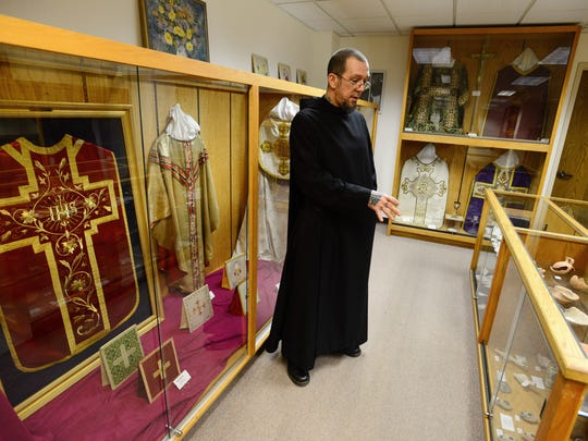 Brother Andre Love, a Benedictine monk, offers a tour of the Mount Angel Abbey's museum. Love is curator of the Abbey's art collection.