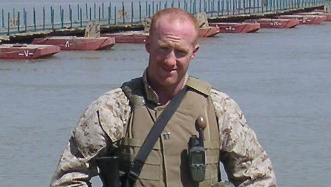 Marine Capt. Brent Morel, a 1999 graduate of the University of Tennessee at Martin, is pictured on the Euphrates River while serving in the Middle East before his death in April 2004.