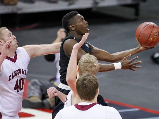 Brown Deer's Lewrenzo Byers, top right, shoots against Prescott's Garrett Ryan (40), Clay Seifert and Joe Haas, front, during the first half of their Division 3 semifinals in the WIAA boys' state basketball championships Friday, March 20, 2015, in Madison, Wis. Brown Deer won 62-50. (AP Photo/Andy Manis)