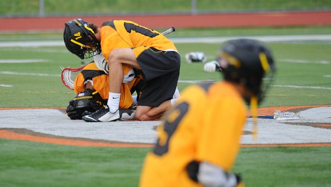 Moorestown's Wesley Sporer consoles his teammate Frankie Labetti after losing to West Morris in the Group 3 final on Wednesday at Cherokee.