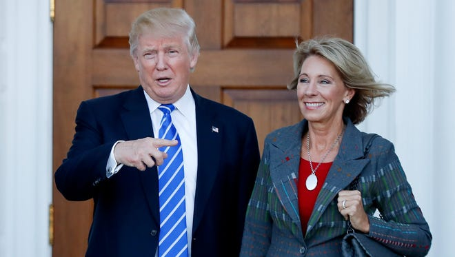 Betsy DeVos, a strong advocate of school choice and school vouchers, with Donald Trump on Nov. 19, 2016.