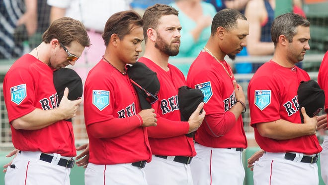 Moments before the playing of the national anthem, Boston Red Sox players join a moment of silence honoring the victims of the shooting at Marjory Stoneman Douglas High School on Friday (2/23/18) at JetBlue Park in south Fort Myers. Red Sox and Minnesota Twins players wore special hats during the game in memory of the victims and the Parkland community.
