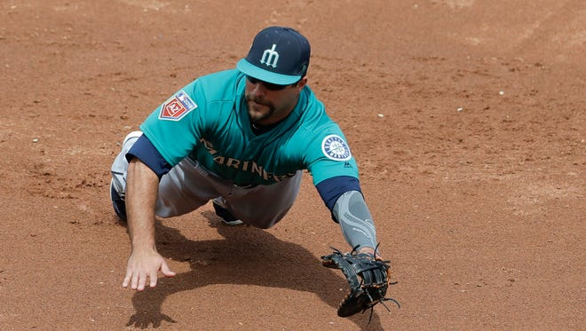 Seattle Mariners first baseman Mike Ford can't get a glove on a double by Colorado Rockies' Charlie Blackmon during the third inning of a spring training baseball game in Scottsdale, Ariz., Tuesday, March 13, 2018.