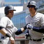 New York Yankees' Alex Rodriguez, right, gets congratulations from Carlos Beltran following his two-run home run off Minnesota Twins pitcher Ricky Nolasco in the seventh inning of a baseball game, Saturday, June 18, 2016, in Minneapolis. Beltran followed with a two-run homer in the eighth inning.
