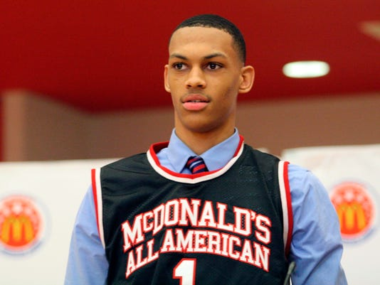 In this Feb. 20, 2018 photo, Darius Bazley wears his new McDonald's All-American Game jersey that was presented to him. Others have taken the straight-line approach from high school to the NBA development league. But Bazley's intention to spend a season in the NBA G League rather than a sham couple of semesters in the classroom should be the catalyst, once and for all, to eliminate the silly one-and-done rule.  (Adam Baum/The Cincinnati Enquirer via AP)