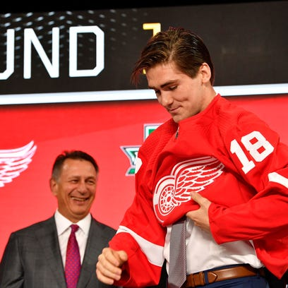 Filip Zadina puts on a Detroit Red Wings jersey after