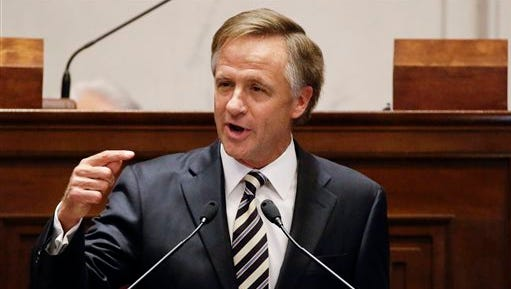 FILE - In this Feb. 9, 2015 file photo, Gov. Bill Haslam delivers his annual State of the State address to the Tennessee Legislature in Nashville, Tenn.  Years of Republican attacks on President Barack Obama's health care law may have paid dividends at the ballot box, but they also made it much harder for GOP governors to make the case that expanding Medicaid in their states is a good idea.   Haslam corralled the broad support of business groups and the state's powerful health care industry for his plan to cover 280,000 low-income residents. He ended up losing out to a steady drumbeat of anti-Obama rhetoric and threats of primary challenges to Republican lawmakers who considered going along.  (AP Photo/Mark Humphrey)