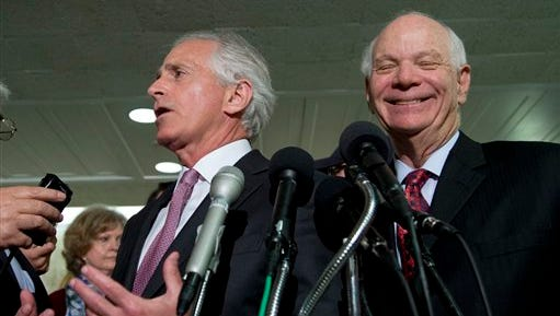 Senate Foreign Relations Committee Chairman Sen. Bob Corker, R-Tenn., left, and Ben Cardin, D-Md.,  speak to reporters on Capitol Hill in Washington after a 19-0 committee vote unanimously approving a bill that would give Congress a say about the emerging deal aimed at preventing Iran from developing nuclear weapons in exchange for sanctions relief.