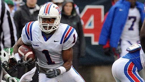 Louisiana Tech Carlos Henderson (1) runs the ball against Marshall during the Conference USA championship NCAA college football game last season.