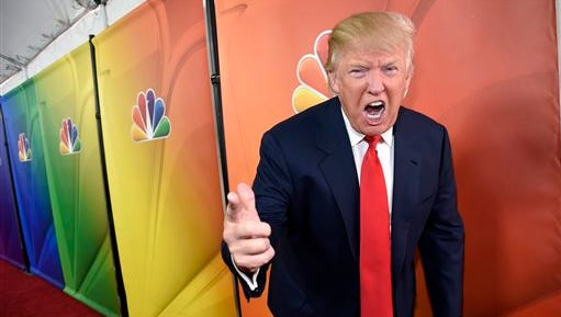 """FILE - In this Jan. 16, 2015 file photo, Donald Trump, host of the television series """"The Celebrity Apprentice,"""" mugs for photographers at the NBC 2015 Winter TCA Press Tour in Pasadena, Calif. NBC on Monday, June 29, 2015 said that it is ending its business relationship with Trump, now a Republican presidential candidate, because of comments he made about immigrants during the announcement of his campaign. (Photo by Chris Pizzello/Invision/AP, File)"""